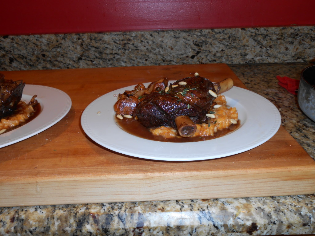 Braised lamb shanks with red wine serrano pepper glaze, sweet potato risotto, and chanterelle mushrooms
