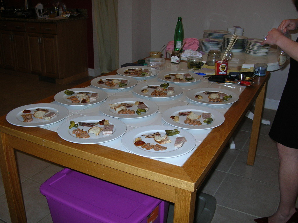 This photo is from a dinner party, but note the large plastic bins underneath the table!  Filled part-way with water and dish soap, dirty dishes go here to wait their turn in the dishwasher