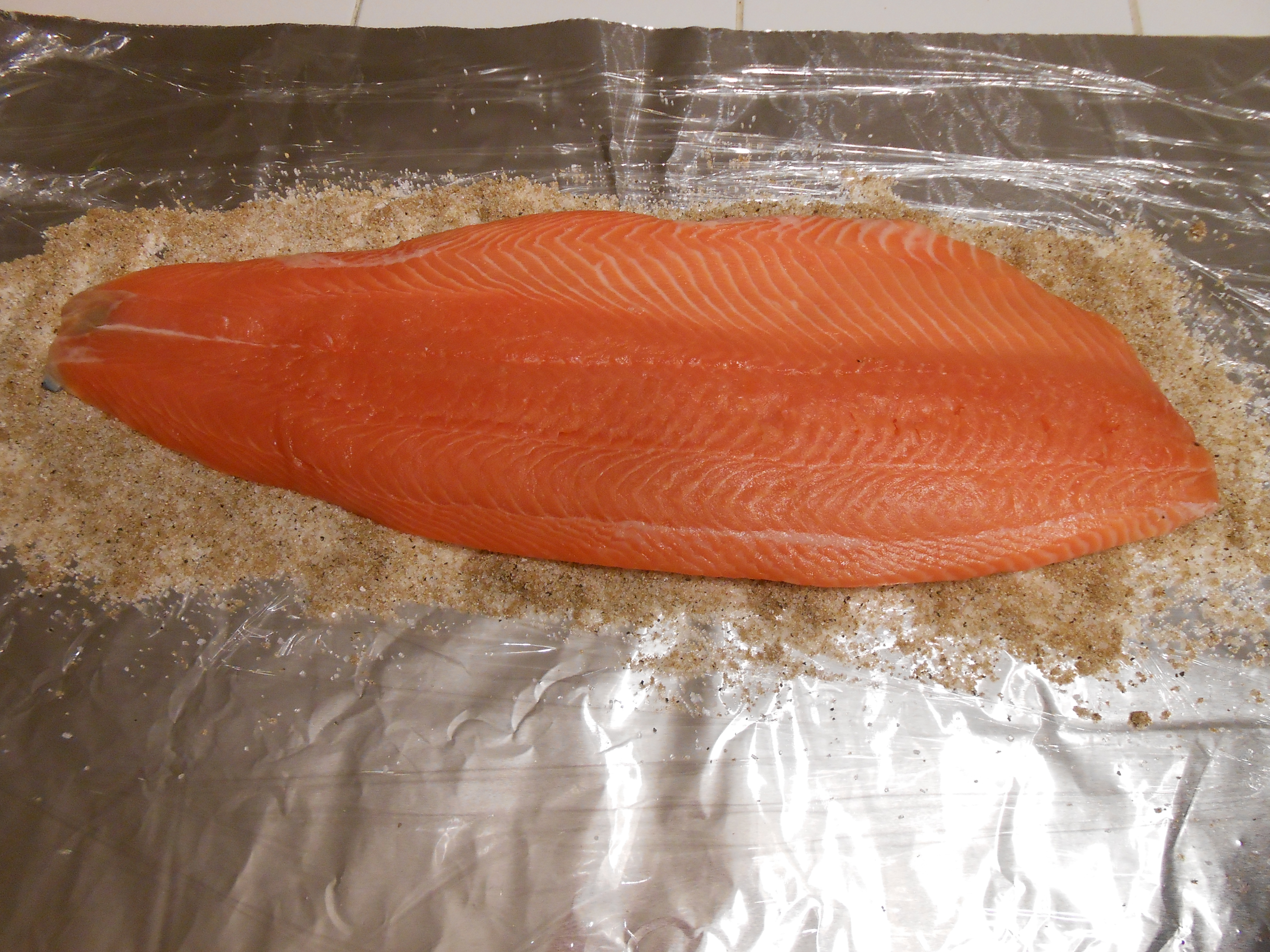 Lay Down A Nice Large Piece Of Salmon On Top This One Is About 3 Pounds  It Is Also Skinless, Which Makes It Easier To Deal With